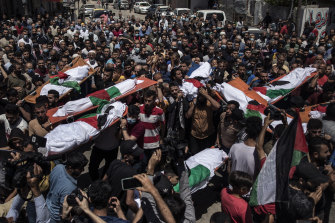 Palestinians attend the funeral of two women and eight children of the Abu Hatab family in Gaza City, who were killed by an Israeli air strike.