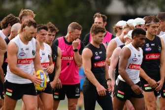 Collingwood coach Nathan Buckley (centre) with his players at training last month.