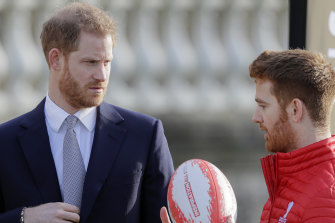 Britain's Prince Harry listens to Rugby League World Cup 2021 ambassador James Simpson.