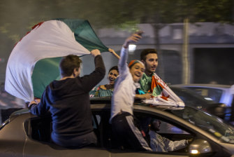 French-Algerian youth in Paris pile into a car to celebrate after Algeria were crowned soccer champions of Africa last month. The driver should not be mistaken for a young Tony Wright.