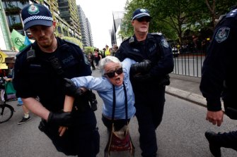 Police drag away a protester in Sydney on October 7.