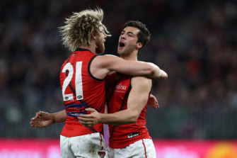 Kyle Langford of the Bombers celebrates a goal with Dyson Heppell.