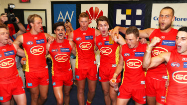 Winners' circle: The Suns sing the song after beating the Bulldogs.