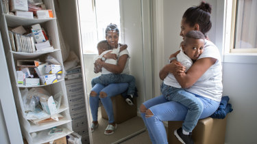 Sara Wayu with her son Caleb and the medical supplies he needs.