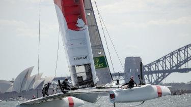 Japan's SailGP team flis across Sydney Harbour.