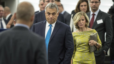 Hungary's Prime Minister Viktor Orban, centre, arrives to deliver his speech at the European Parliament in Strasbourg, France.
