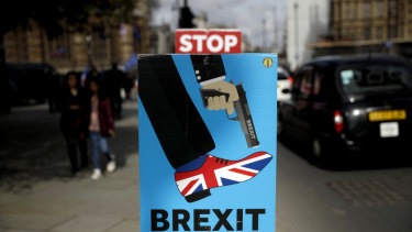 An anti-Brexit placard outside the Houses of Parliament in London.