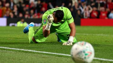 United's Sergio Romero celebrates a penalty save.