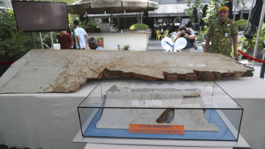 Debris from the missing Malaysia Airlines Flight MH370 on display display at the Day of Remembrance event.