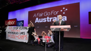 Protesters take to the stage as Bill Shorten delivers his opening address to Labor's triennial national conference.