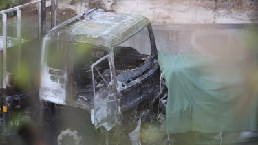 The burnt-out cab of one of the trucks involved in the crash.