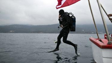 Lead archaeologist Dimitris Kourkoumelis dives to the shipwreck.