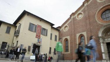 Visitors walk outside the ''Last Supper, Cenacolo'' museum in Milan on the 500th anniversary of Leonardo da Vinci's death, in Milan.