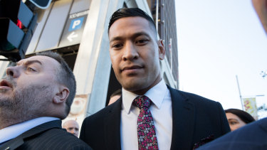 Israel Folau arrives at the Fair Work Commission on Friday for a conciliation meeting.