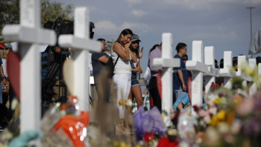 People visit a makeshift memorial at the site of a mass shooting at a shopping complex, in El Paso last month.