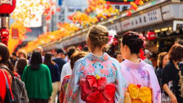 Tourists wear kimonos in Tokyo.