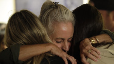 Mourners embrace during a vigil to remember victims of the Thousand Oaks shooting.