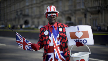 Leave the European Union supporter Joseph Afrane, aged 55 from London and originally from Ghana, poses for photographs outside the Houses of Parliament in London.