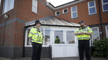 British police officers guard a cordon outside the Amesbury Baptist Centre on Wednesday.
