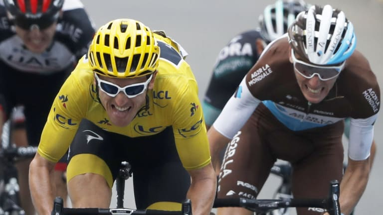 Out in front: Geraint Thomas in the yellow jersey.