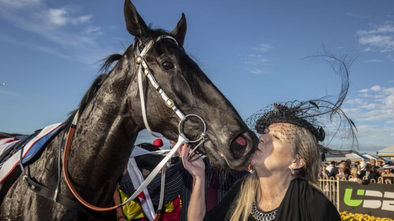 My baby: Mary Jane Basson gives Derby winner Dark Dream a kiss.