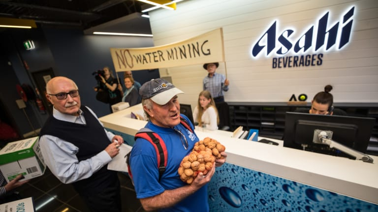 Stanley Farmer David McIntyre is part of a protest with other locals delivering fruit to the head office of Asahi.