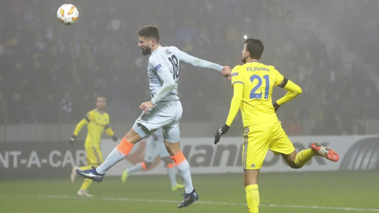 Chelsea's Oliver Giroud heads the ball in the Europa League match against BATE Borisov.