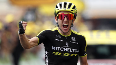 Simon Yates celebrates as he crosses the finish line.