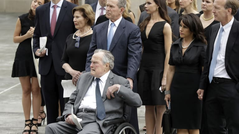 """George H.W. Bush (in wheelchair) used the """"thousand points of light"""" slogan to encourage volunteerism."""