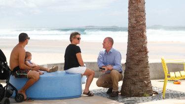 Labor candidate Craig Elliott talks with locals while campaigning