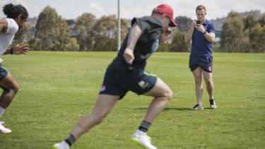 Andrew Heffernan keeps an eye on rugby league stars Blake Austin and Sia Soliola.