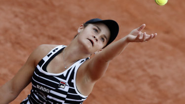 On a roll: Ash Barty prepares to serve in her French Open encounter with American Danielle Collins.