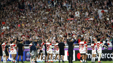 Japan's players acknowledge their supporters after the famous victory over Scotland.