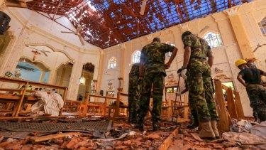 Soldiers inspect the damage inside St. Sebastian's Church in Negombo, Sri Lanka.