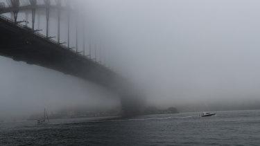 Fog around the Sydney Harbour Bridge.