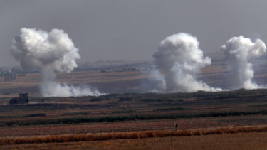 Smoke billows from targets inside Syria during bombardment by Turkish forces on Thursday.