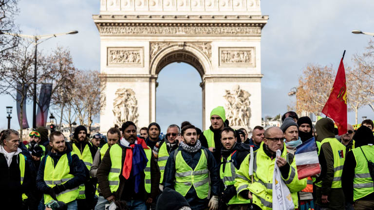 Destined for a museum ... protesters wearing yellow vests in front of the Arc de Triomph in Paris.