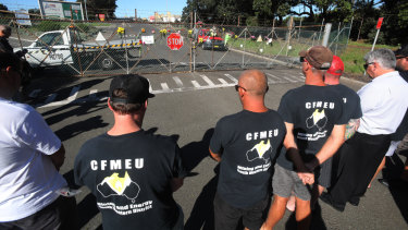 Locked-out Port Kembla Coal Terminal union workers paid tribute to their colleague.
