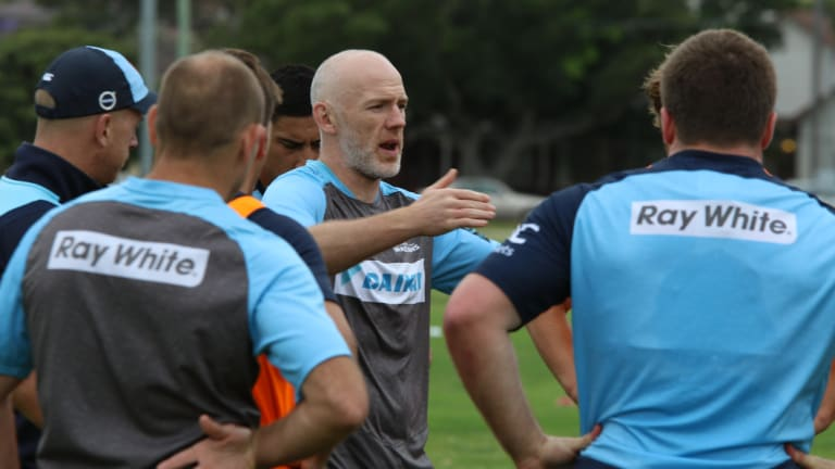 Former Ospreys flanker Steve Tandy has joined the Waratahs as defence coach on a two-year deal.