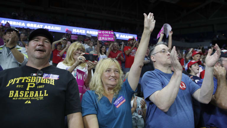 Supporters cheer as President Donald Trump speaks during a rally last week.