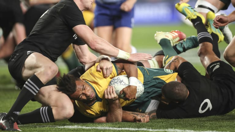 Rare sight: Will Genia scored Australia's first try. Only one more was to come for the visitors in a 40-12 loss.