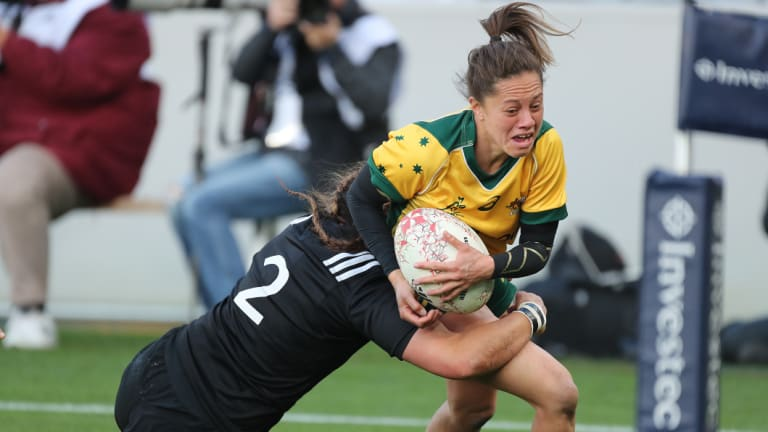 Not enough: Cobie-Jane Morgan is hauled down by the Black Ferns defence.