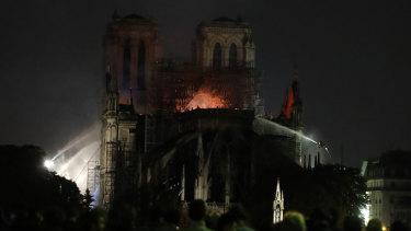 People watch Notre Dame cathedral burning in Paris.