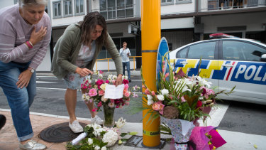 'Home grown love for all': Locals lay flowers near the Al Noor Mosque in Christchurch on Saturday morning.