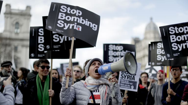 Members of the Stop the War coalition protest outside the Houses of Parliament in London on Monday.