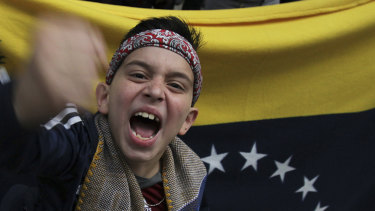 A Venezuelan boy joins a protest outside the Venezuelan embassy in Mexico City in January.
