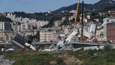 Rescuers work among the rubble of the Morandi highway bridge.