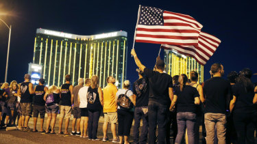 People form a human chain around the shuttered site of a country music festival where a gunman opened fire on the first anniversary of the mass shooting in Las Vegas.