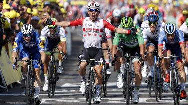 Ewan celebrates as he crosses the finish line.