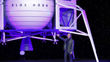 Jeff Bezos in front of a model of Blue Origin's Blue Moon lunar lander on Thursday.